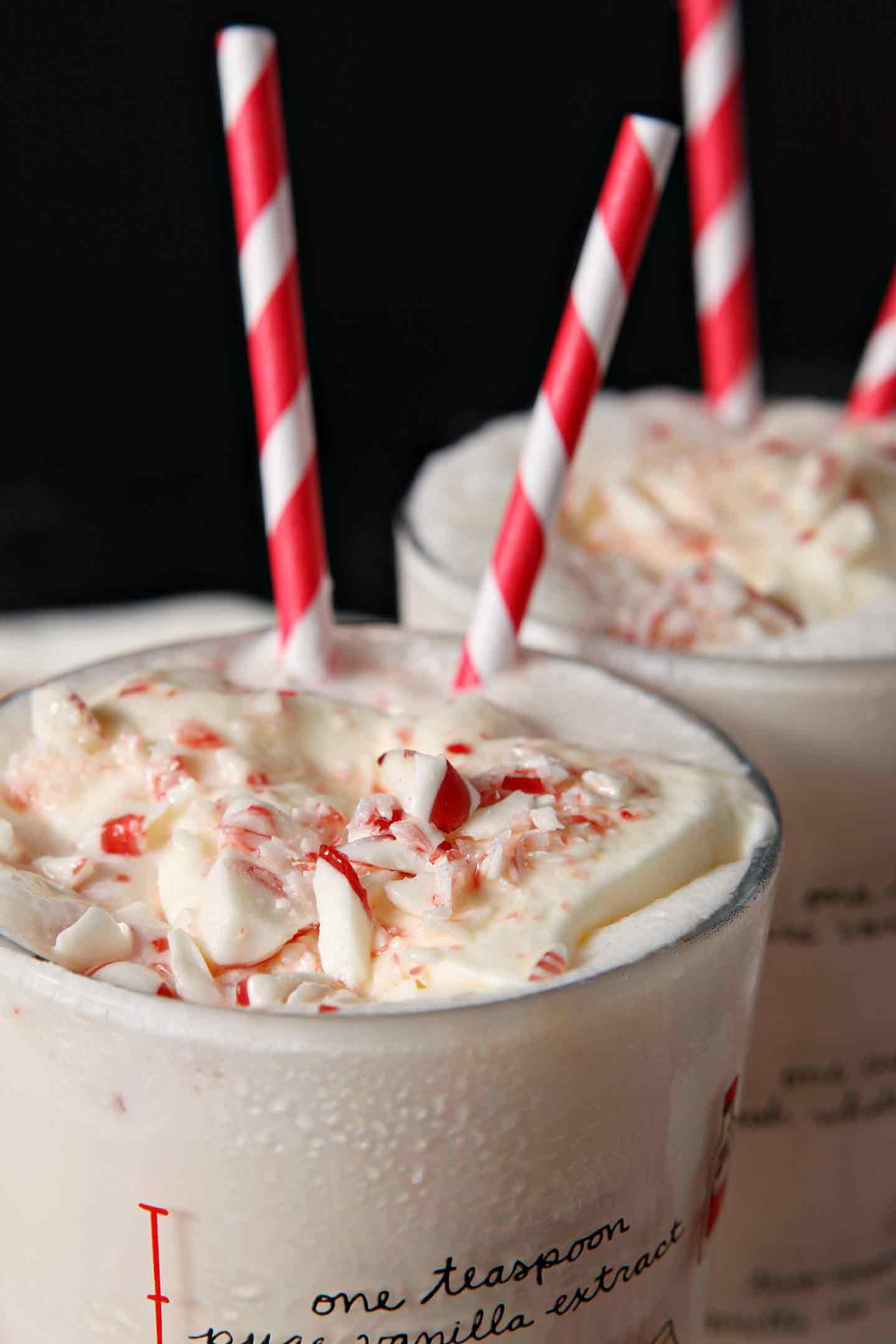 Get in the holiday spirit by whipping up No Churn Peppermint Ice Cream Milkshake! You don't need an ice cream maker for this recipe. Whip heavy whipping cream, then add sweetened condensed milk, pure peppermint extract and candy cane pieces. Stir gently until combined, then freeze. When it's time to make the milkshake, scoop the ice cream into a blender, and mix with milk. A smooth, pepperminty shake is the BEST holiday dessert! #spon