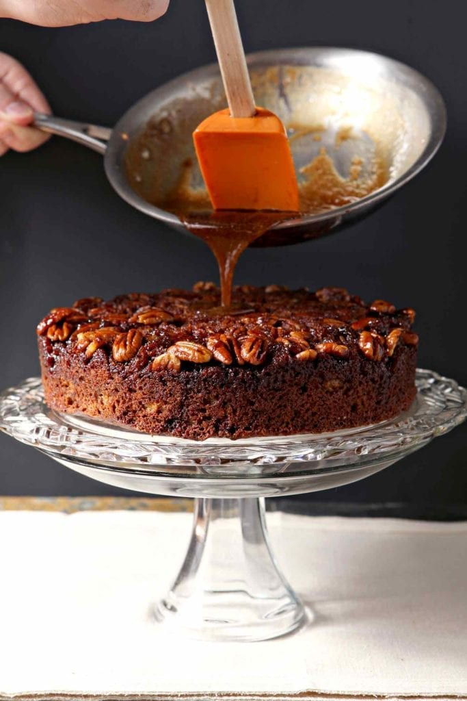 Bourbon Caramel Glaze pours over a cake dotted with pecan halves