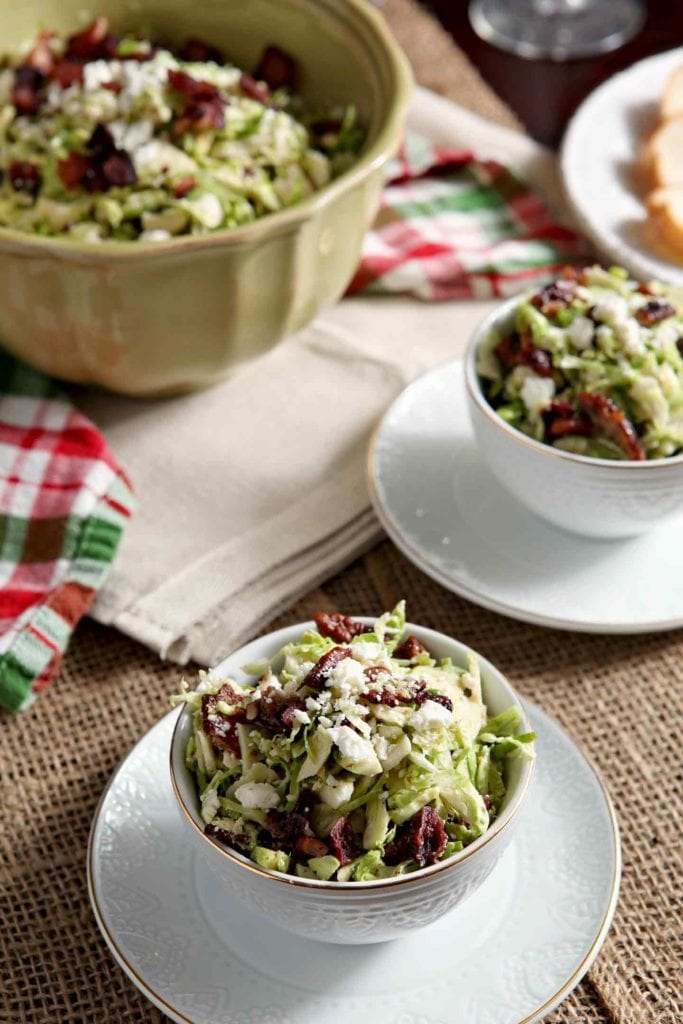 bacon feta brussels sprouts salad in two white bowls