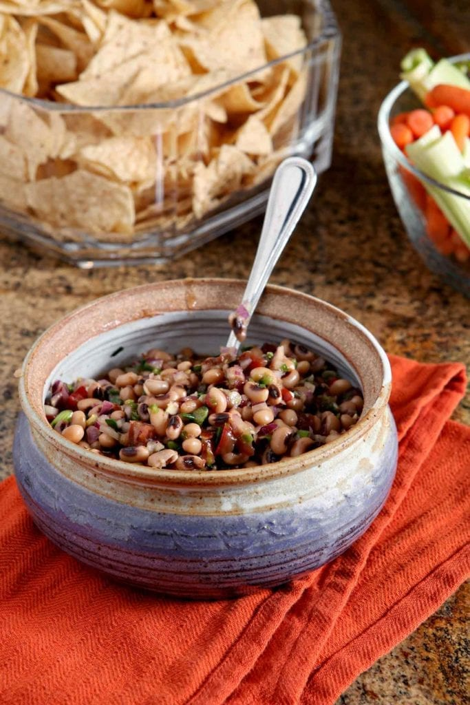 Instead of making Hoppin' John, serve Black Eyed Pea Dip to guests on New Year's Day. A nod to the traditional Southern recipe, this app calls for similar ingredients. Chock full of black eyed peas, heirloom tomatoes, red onion, jalapeño and some green onions, this vegetarian dip comes together with a honey-balsamic dressing. Serve Black Eyed Pea Dip with corn or tortilla chips. What a scrumptious appetizer to bring prosperity in the new year!