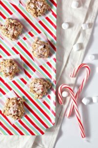 No Bake Peppermint Bark Cookies are shown from above on a colorful platter with marshmallows and candy canes