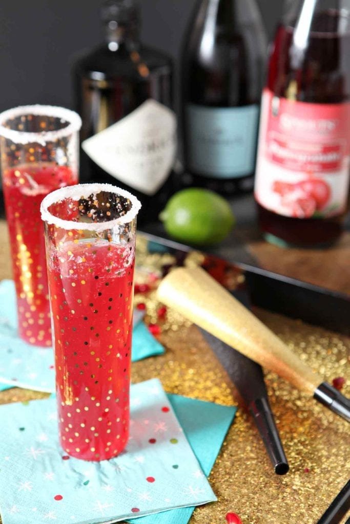 The Pomegranate French 75 makes a perfect celebratory cocktail to sip while ringing in the new year! A twist on a classic French 75, this recipe calls for prosecco or champagne, gin, freshly squeezed lime juice and Sprouts Pomegranate Italian Soda. The resulting drink is light, herbaceous and slightly sweet and a little tart. The effervescent Pomegranate French 75 would be a beautiful mixed cocktail to serve at a New Year's Eve party! #ad