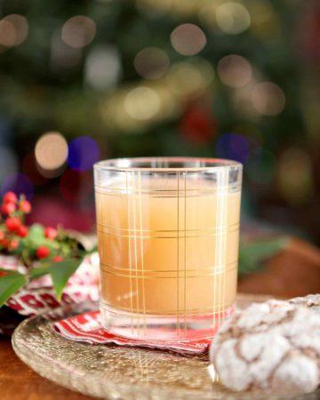 vegan bourbon pecan milk in a glass with cookies