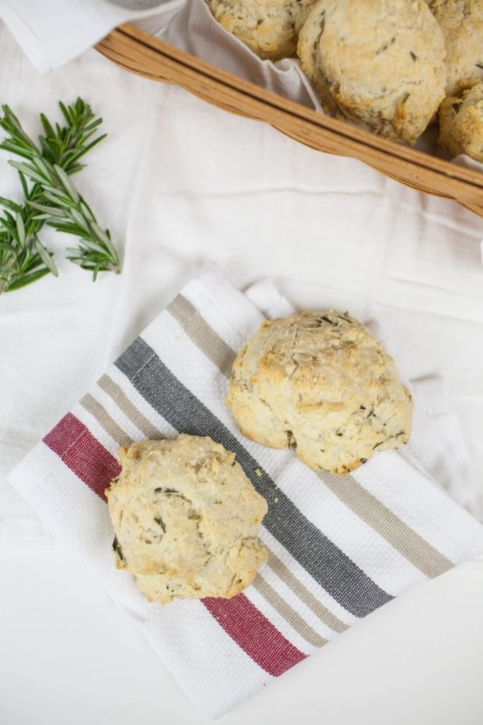Quick Rosemary Drop Biscuits make a delicious bread to serve alongside any holiday or weeknight dinner. These quick biscuits require just a handful of simple ingredients, which include fresh rosemary, butter, flour and more. Combine the ingredients, and dollop onto a prepared baking sheet, then bake. From start to finish, these biscuits are on the table in just 20 minutes. What's not to love about these easy, fluffy, flavorful biscuits?