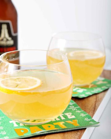 Mix up a batch of seasonal Meyer Lemon Shandies for your guests as you watch the Big Game! This twist on a classic Shandy celebrates winter citrus. First, make a tart Meyer Lemonade that will serve as the base for this cocktail. When the lemonade has chilled, pour in a fruity wheat beer. Garnish with a slice of Meyer lemon, and enjoy. These Shandies make a delightfully tart tailgating drink, as well as a simple sipper for any winter get-together.