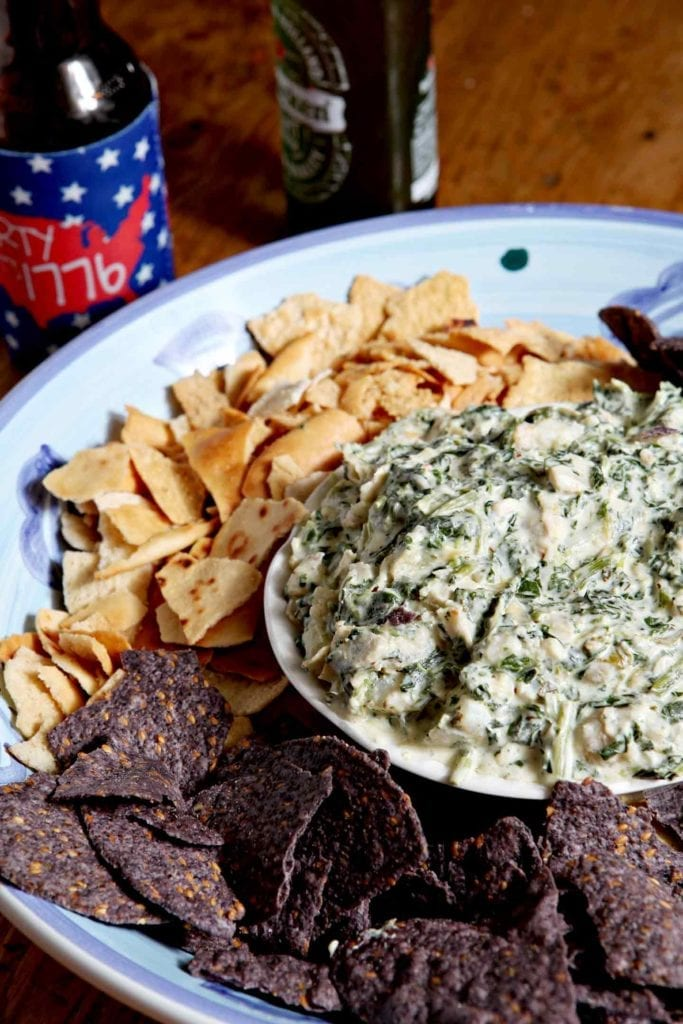 Shake up your usual go-to appetizers by bringing Shrimp Spinach Artichoke Dip to the get-together this year! Shrimp add flavor to this twist on a well-loved classic. Cook the shrimp in butter, then toss into a combination of artichoke hearts, chopped spinach, garlic, cream cheese and parmesan to create this gooey dip. Serve warm with tortilla or pita chips. Wow your party guests with flavorful, familiar-but-different Shrimp Spinach Artichoke Dip.