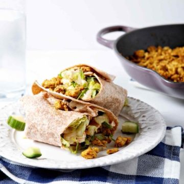 Healthy lunches don't have to be boring. Turkey Shawarma Wraps make a flavorful, healthy lunch to enjoy in the new year! Season Jennie-O Extra Lean Ground Turkey Breast with curry powder, cumin, salt and pepper, and cook with garlic, spritzing with fresh lemon when finished. In a whole wheat tortilla wrap, layer a salad tossed in homemade Greek dressing, then add the turkey. Wrap like a burrito, secure with toothpicks, cut in half, and enjoy! #ad #JennieO #SwitchCircle