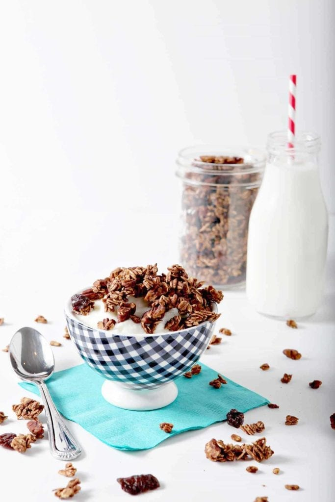 Start the morning with naturally sweetened Dark Chocolate Cherry Granola. Gluten free, vegan and refined sugar-free, this granola makes a tasty breakfast or snack. Toss rolled oats and pecans in unsweetened cocoa powder, then coat in a mixture of maple syrup and water before baking. When crisp, let the granola come to room temperature, then add the dried tart cherries. Enjoy by the handful, over yogurt, with milk or whatever suits your fancy.