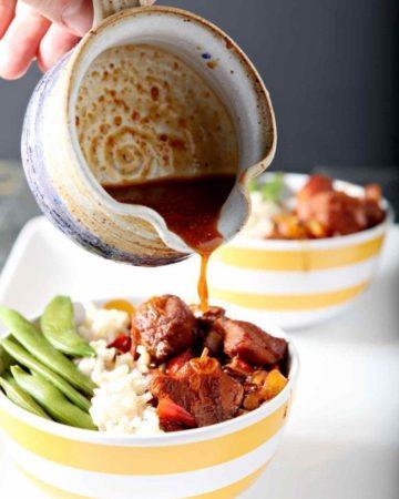 pouring honey sriracha sauce on a rice bowl