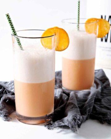 winter citrus smoothie in glasses with orange slices