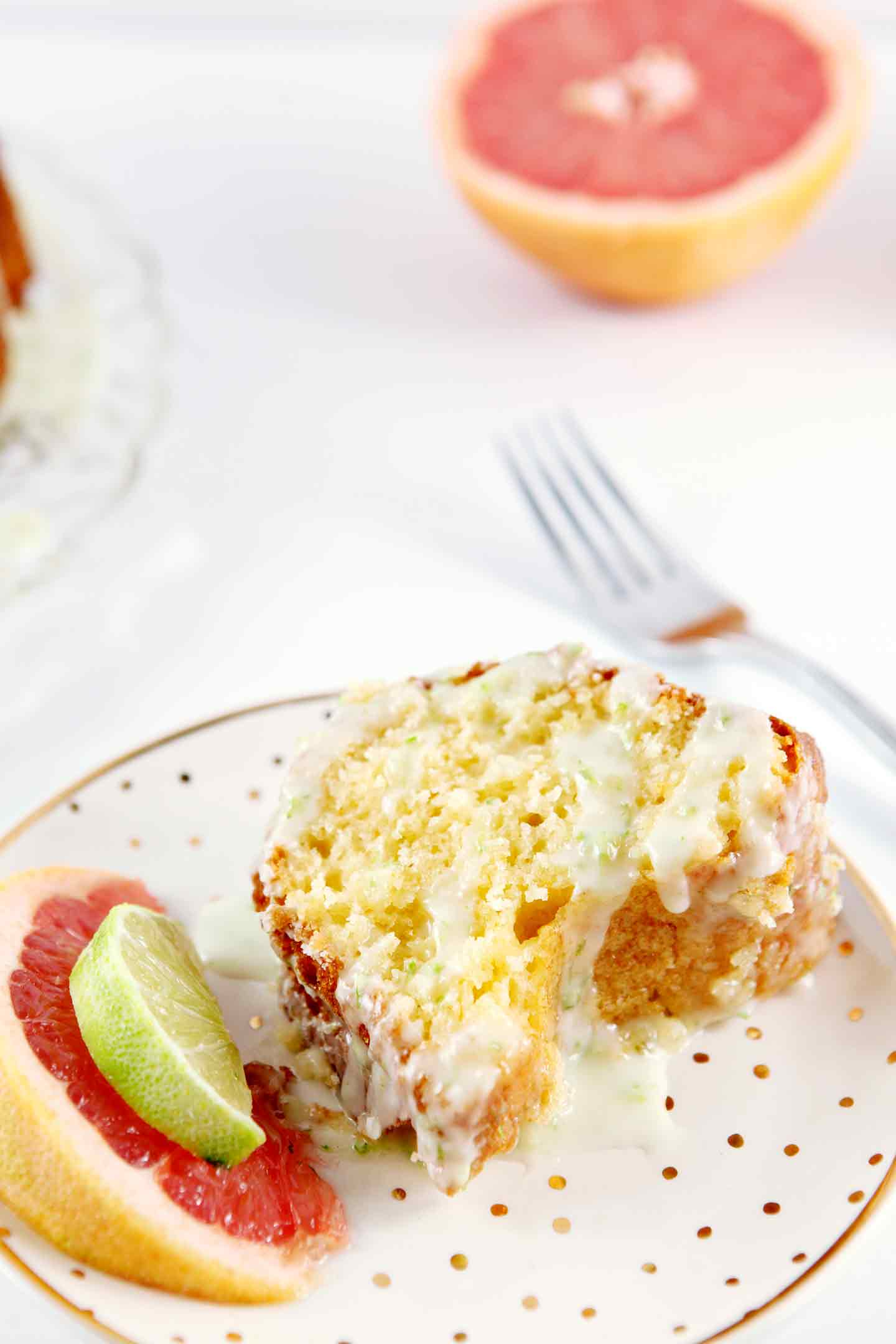 Grapefruit lovers, rejoice, and bake a dairy-free Paloma Citrus Cake with Tequila-Lime Glaze immediately! This dense baked good, inspired by the classic tequila, lime and grapefruit Paloma cocktail, makes a perfect dessert for any occasion and feeds a crowd. Whether you're hosting a party or enjoying a weeknight by your lonesome, this citrusy cake and its boozy glaze are a delicious treat. All you need are simple baking supplies and grapefruit juice!