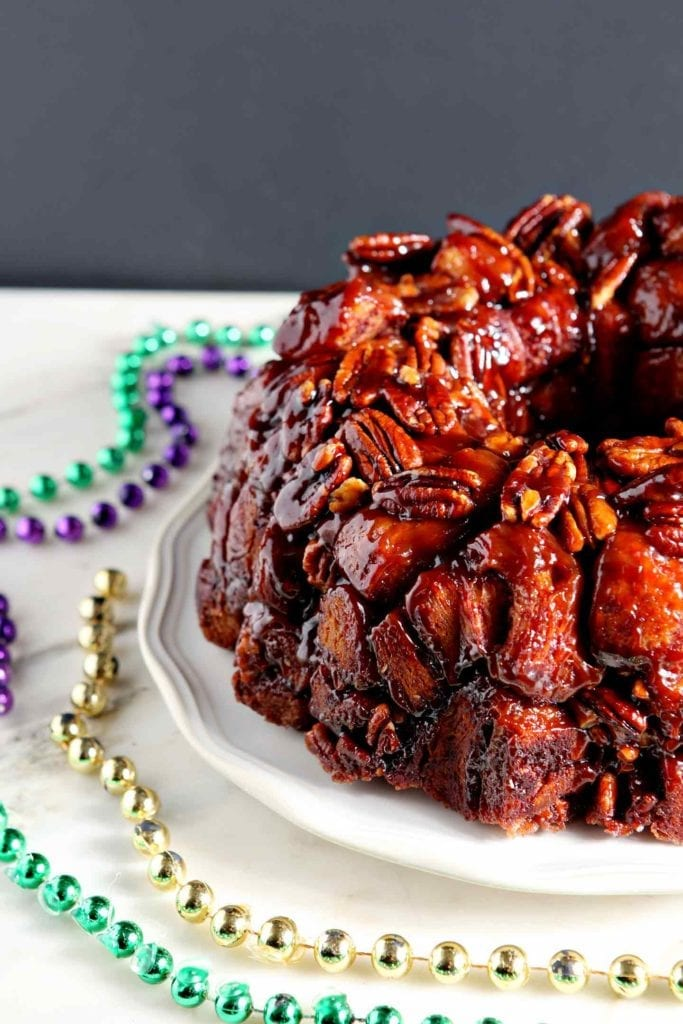 Close up of pecans and cinnamon rolls featured in an easy king cake recipe