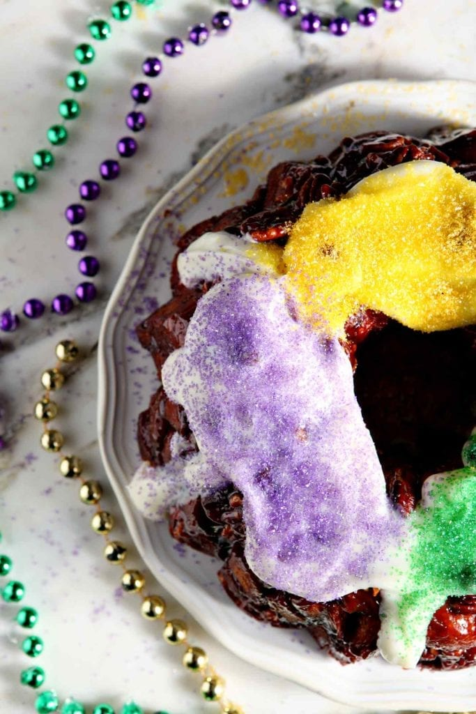 Close up of the sugar decorations on an easy king cake recipe involving cinnamon rolls