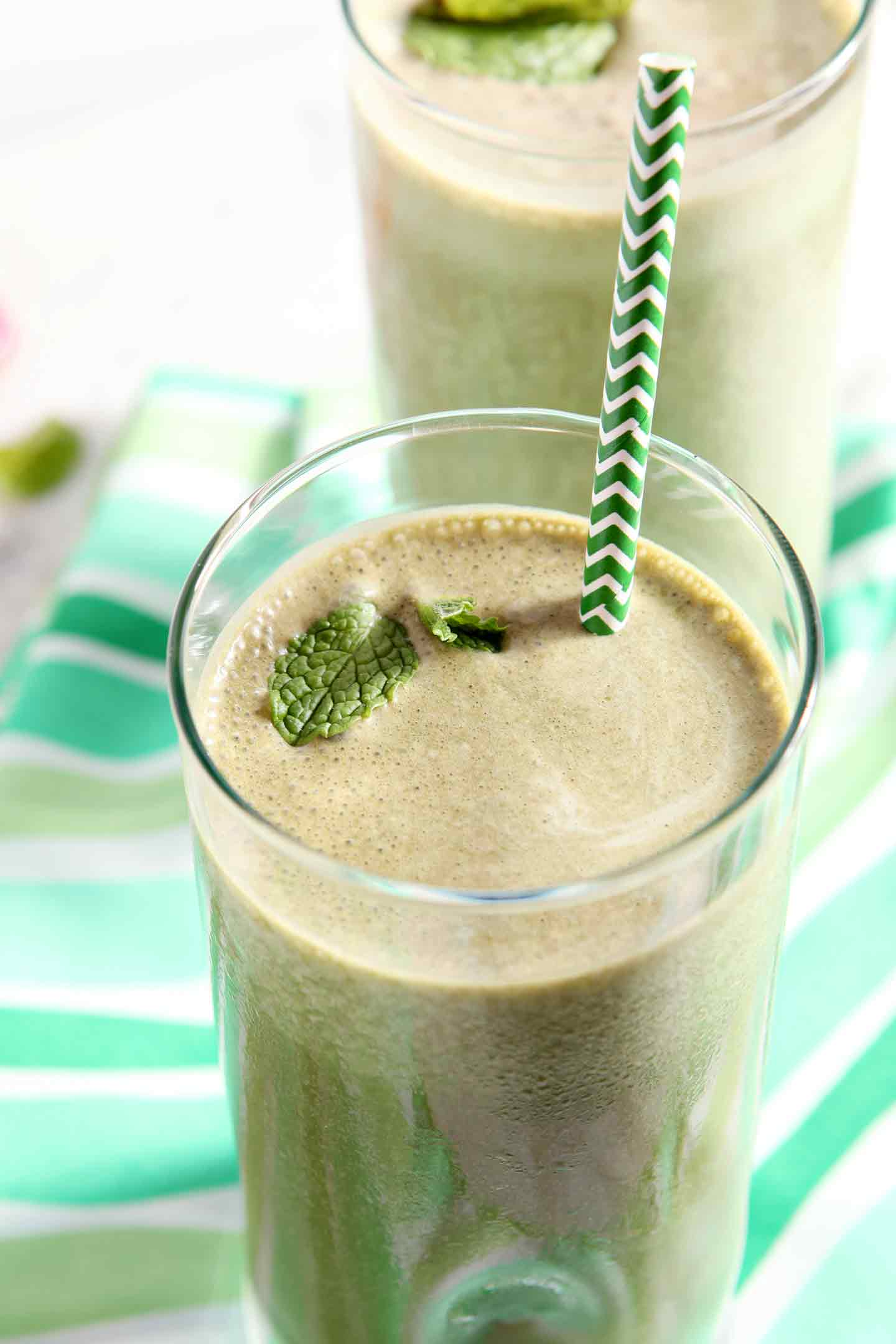 thin mint smoothie in a glass with a green straw