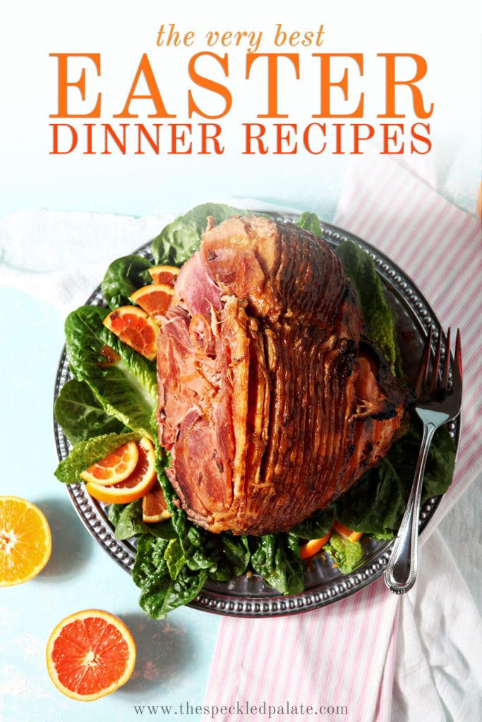 A roasted ham with sliced citrus on a turquoise surface with the text 'the very best easter dinner recipes'