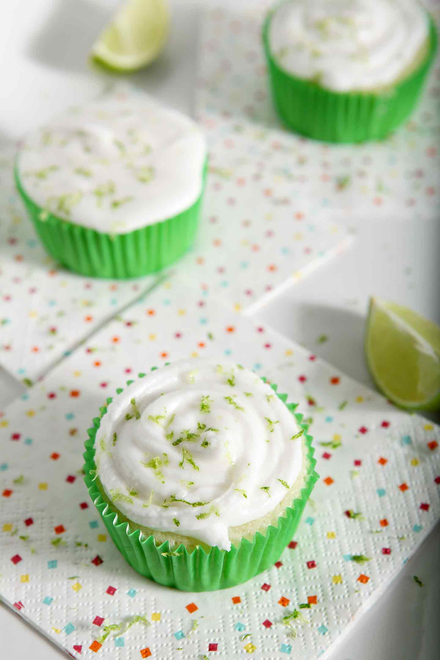 Three Margarita Cupcakes with Salted Tequila Frosting are displayed on a white tray