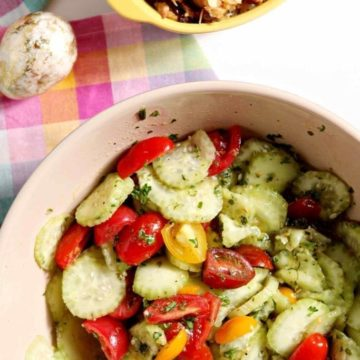 Mediterranean Cucumber Salad with Heirloom Tomatoes and Lemon Vinaigrette makes a delicious side for a spring or summer get-together, BBQ, Easter meal and more! #recipe #sidedish #salad