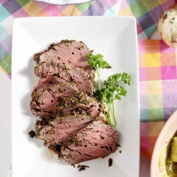 Mediterranean Herb Crusted Beef Tenderloin makes an elegant centerpiece for Easter, Thanksgiving, Christmas, birthday dinners and more! #entree #recipe #holidaymeal