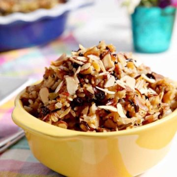 Wild Rice Salad with Dried Fruit and Almonds makes a sweet-savory side! This lemony vegan wild rice dish highlights toasted almonds, dried apricot and currant! #recipe #Easter #Christmas #Thanksgiving #holiday #side