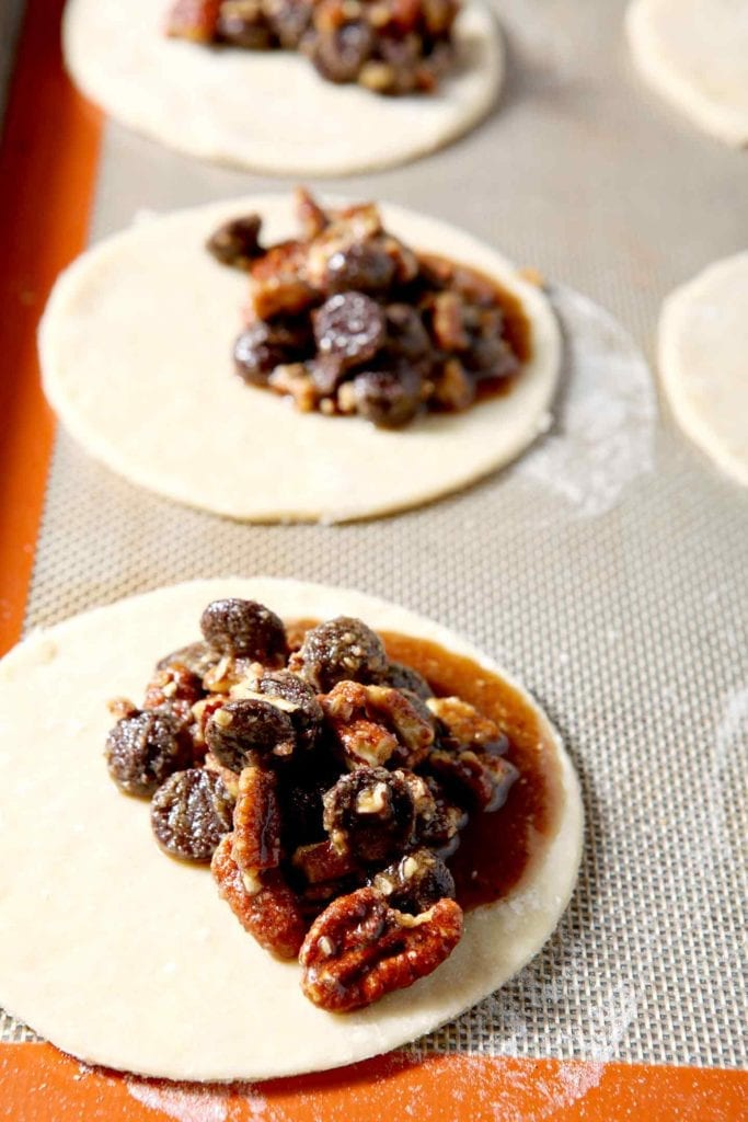 The chocolate, bourbon and pecan filling seeps out of Chocolate Bourbon Pecan Hand Pies before they bake