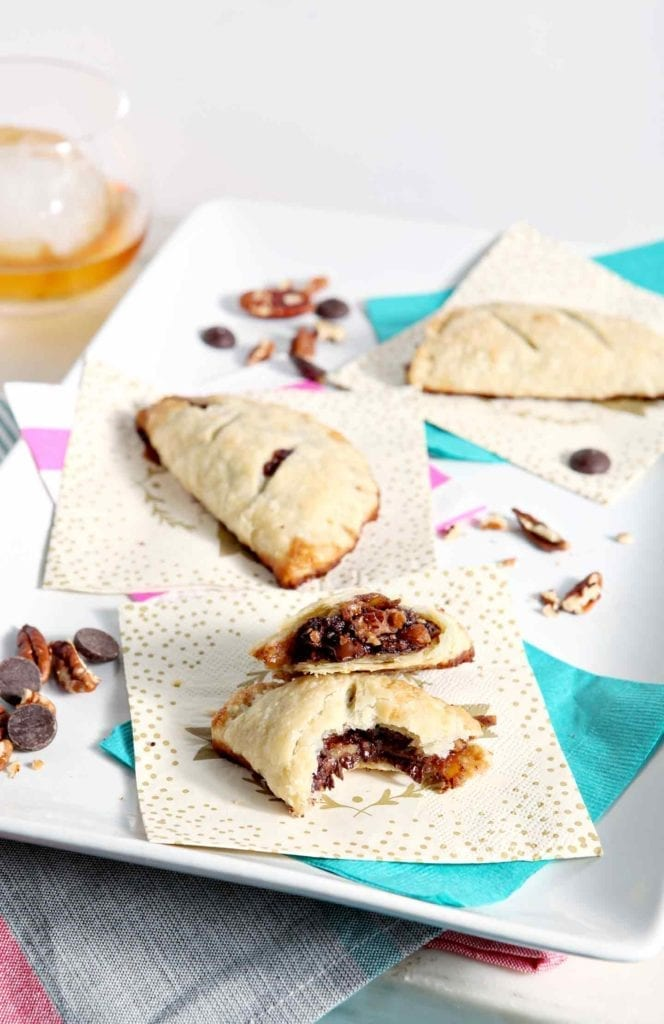 A twist on the classic Kentucky Derby fan-favorite pie, Chocolate Bourbon Pecan Hand Pies make a delightful hand-held dessert for Derby Day... or any other! #recipe #DerbyDay