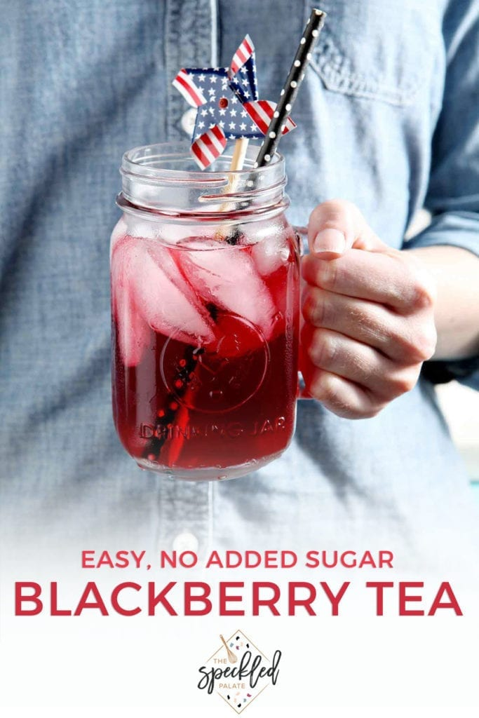 A woman wearing a blue jean shirt holds the glass of blackberry tea with the text 'easy, no added sugar blackberry tea'
