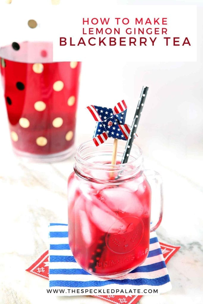 A mason jar holds a serving of blackberry tea with ice cubes and a patriotic pinwheel garnish with the text 'how to make lemon ginger blackberry tea'