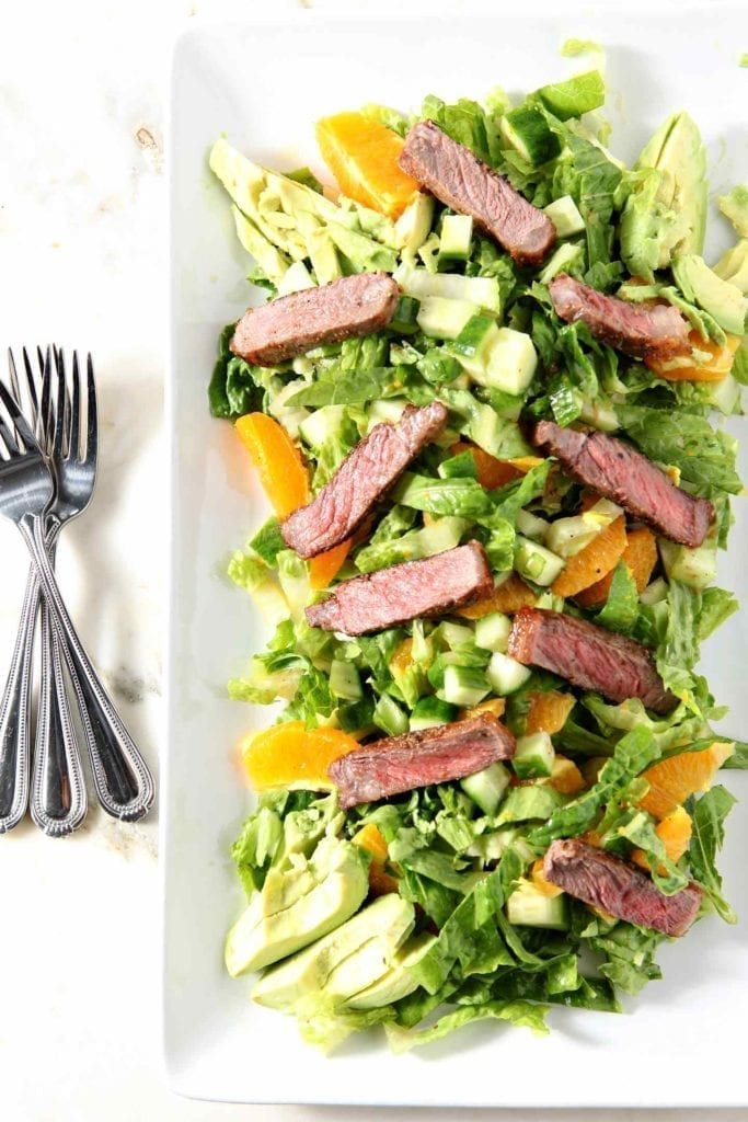 Wow the crowd this summer with Orange Steak Salad! This Whole30-compliant, Paleo and Gluten Free recipe makes the perfect appetizer or meal. #recipe #Whole30