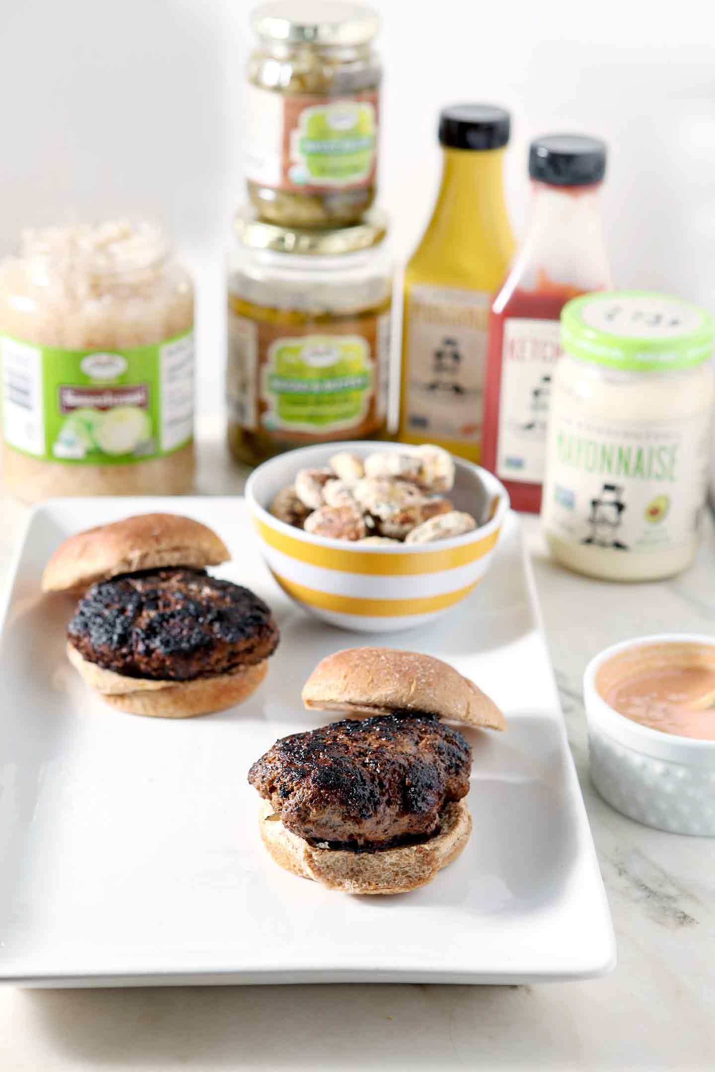 Up your burger game with Sweet and Sauer Burgers. Sauerkraut Burgers with Oven Fried Pickles and Sweet Sriracha Sauce are sure to be a hit this season! #ad #MyBestBurger