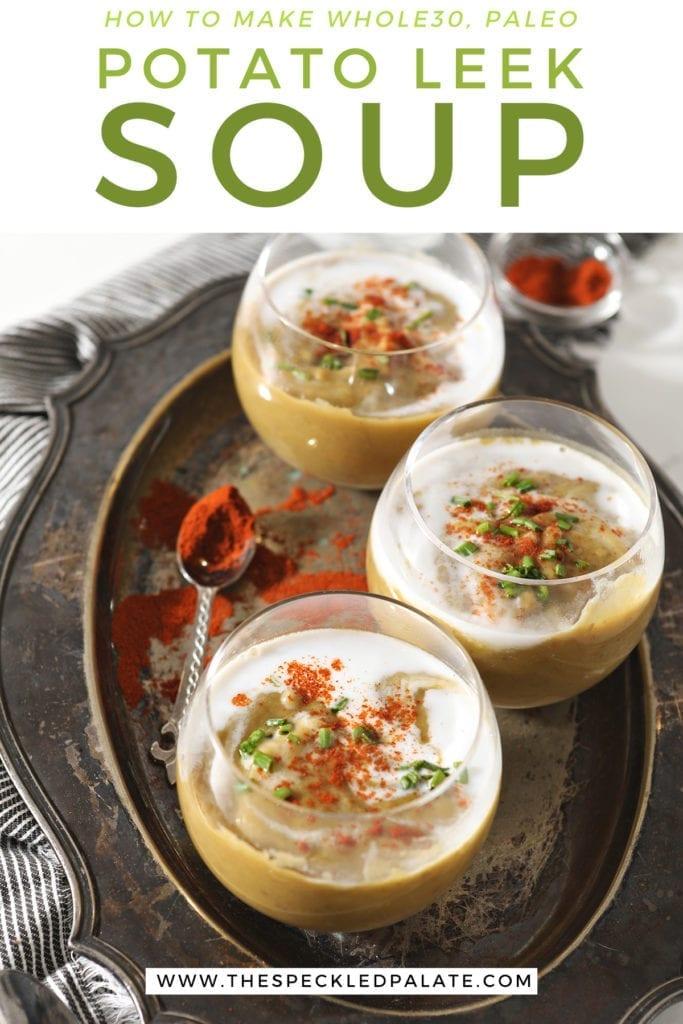 Three glass bowls hold potato leek soup on a silver tray with the text 'how to make whole30, paleo potato leek soup'