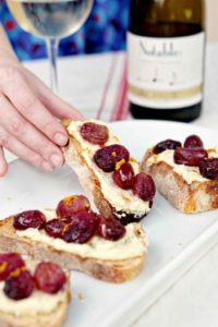 Host friends for a patio wine tasting party this summer! Roasted Grape Bruschetta with Whipped Feta makes a delicious appetizer to pair with white wines. #ad #Chardonnation #SpringWine