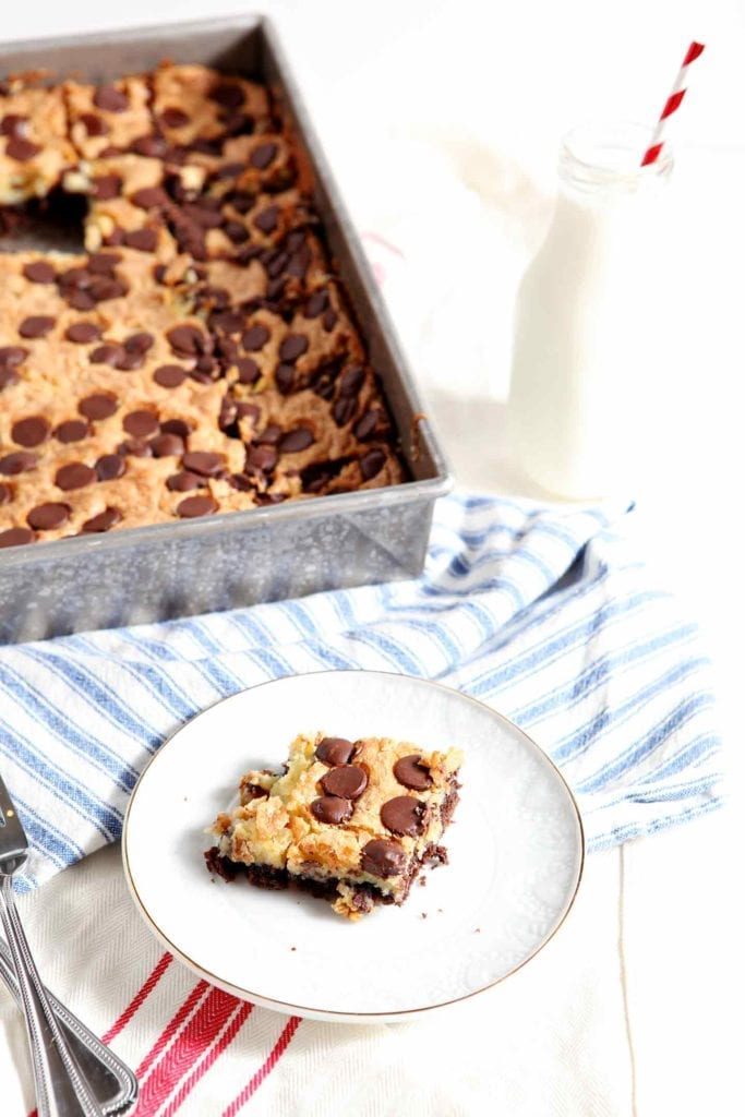 Chocolate-y, cheesecake-y dessert perfection, Ooey Gooey Bars are what you need to bake for dessert. A word of warning: Ooey Gooey Bars are addictive! #recipe #dessert