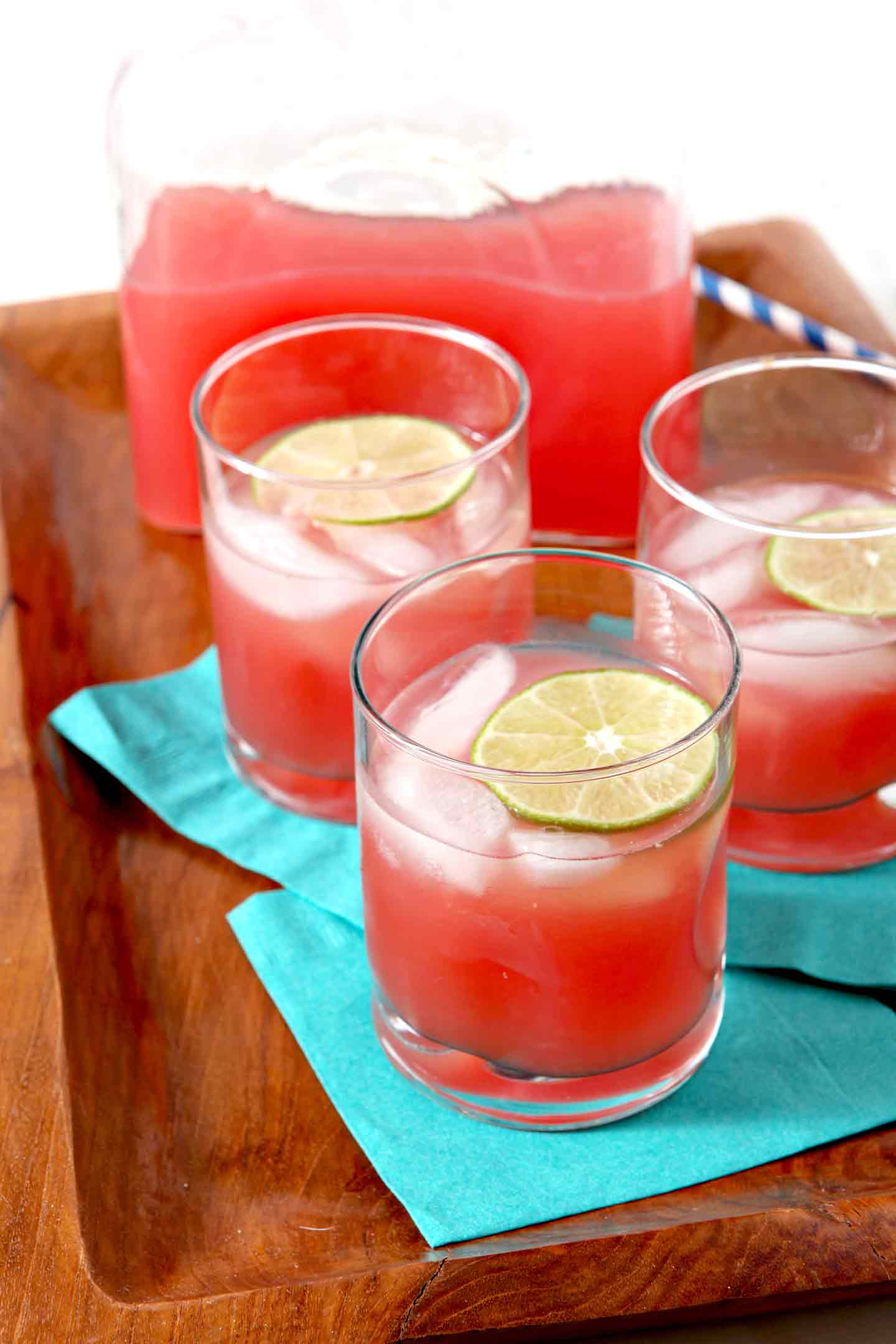 Spiked Watermelon Limeade is the pitcher drink of our dreams! Featuring just four ingredients - watermelon, mint, lime and vodka - this beautiful red cocktail makes an amazing summertime sipper! #recipe #cocktail