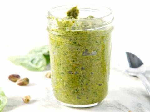 Clean eating doesn't have to be tasteless! This Whole30-compliant, dairy free AND vegan Spinach Pistachio Pesto adds a flavorful punch to any meal. #recipe #Whole30