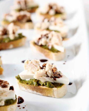 tuna pesto crostini on a white tray