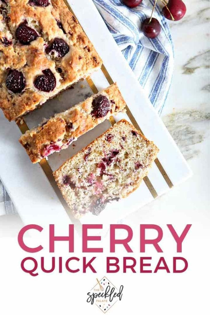 Slices of cherry bread on a marble tray over a blue and white striped towel with the text 'cherry quick bread'