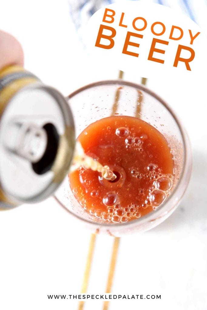 A beer pours into bloody mary mix, with Pinterest text