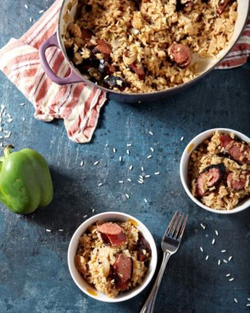turkey sausage jambalaya in a large dish and in two small bowls