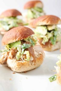 A platter of Shredded Applesauce Chicken Sliders with Brussels Sprouts Apple Slaw for serving