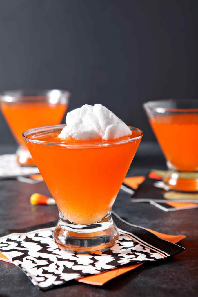Close up of a Candy Corn Halloween Martini with cotton candy floating on top