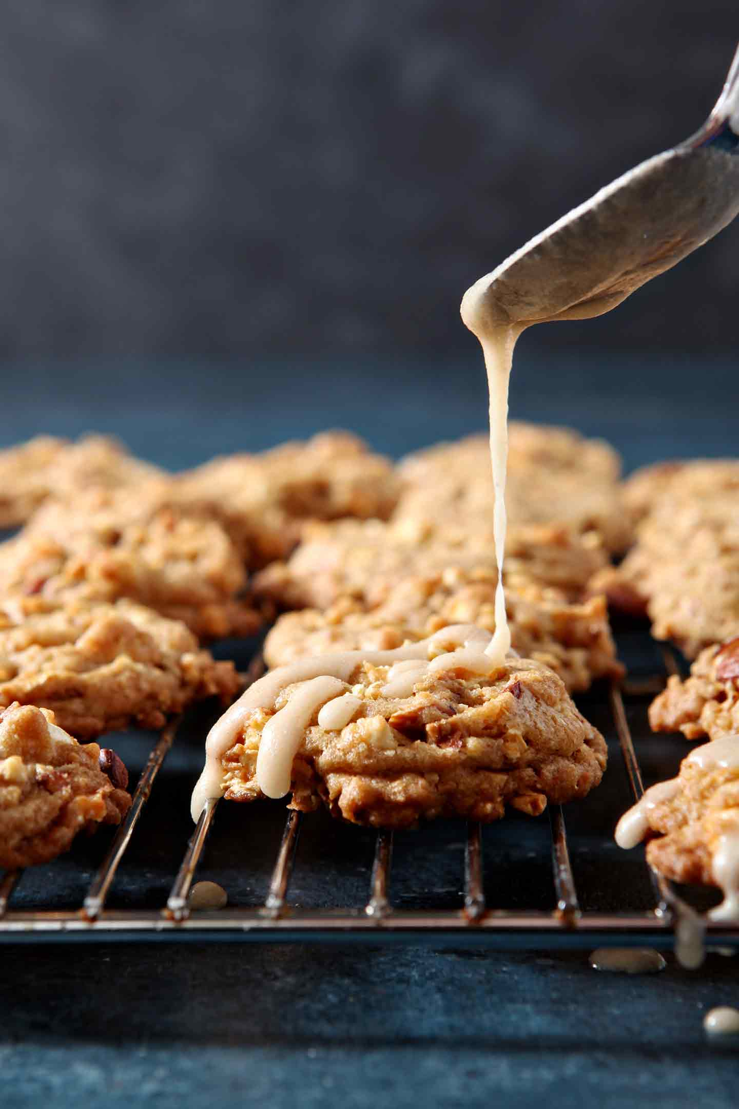 Icing is drizzled onto Caramel Corn Cookies, sitting on a wire cooling rack