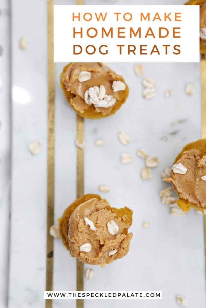 Overhead of iced Peanut Butter Pumpkin Pupcakes on marble with the text 'how to make homemade dog treats'