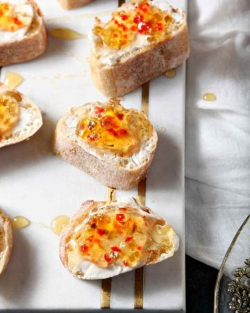 cream cheese bruschetta on a white tray
