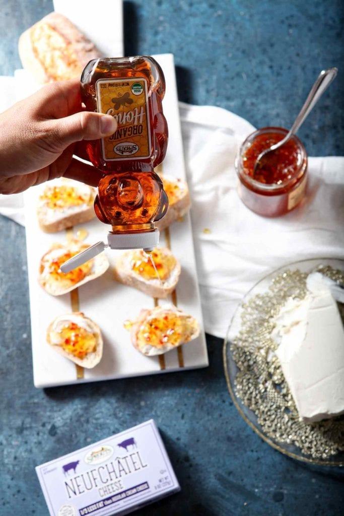 pepper jelly bruschetta on a white tray