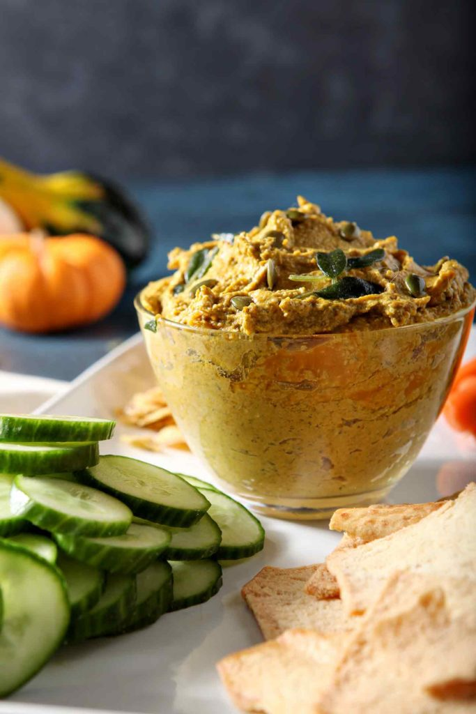 Close up of a bowl of the Sage Pumpkin Hummus, from the side