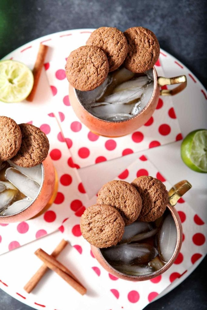 Three Gingerbread Mules, garnished with ginger cookies, are shown from above on a white platter