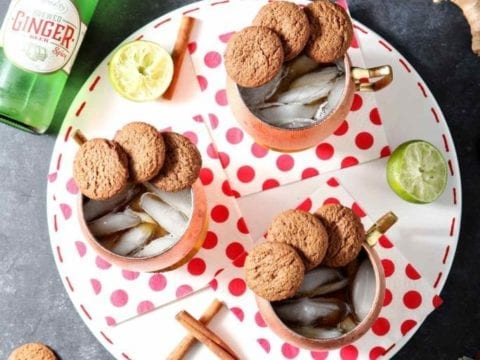 three gingerbread mules on a plate with polka dot napkins