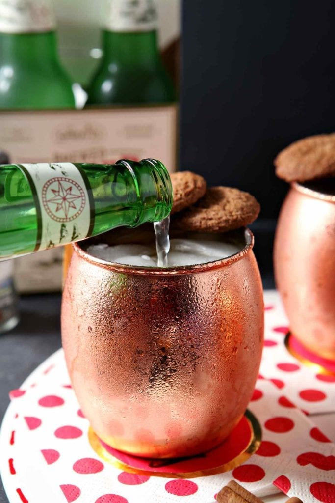 pouring ginger beer in a copper mug