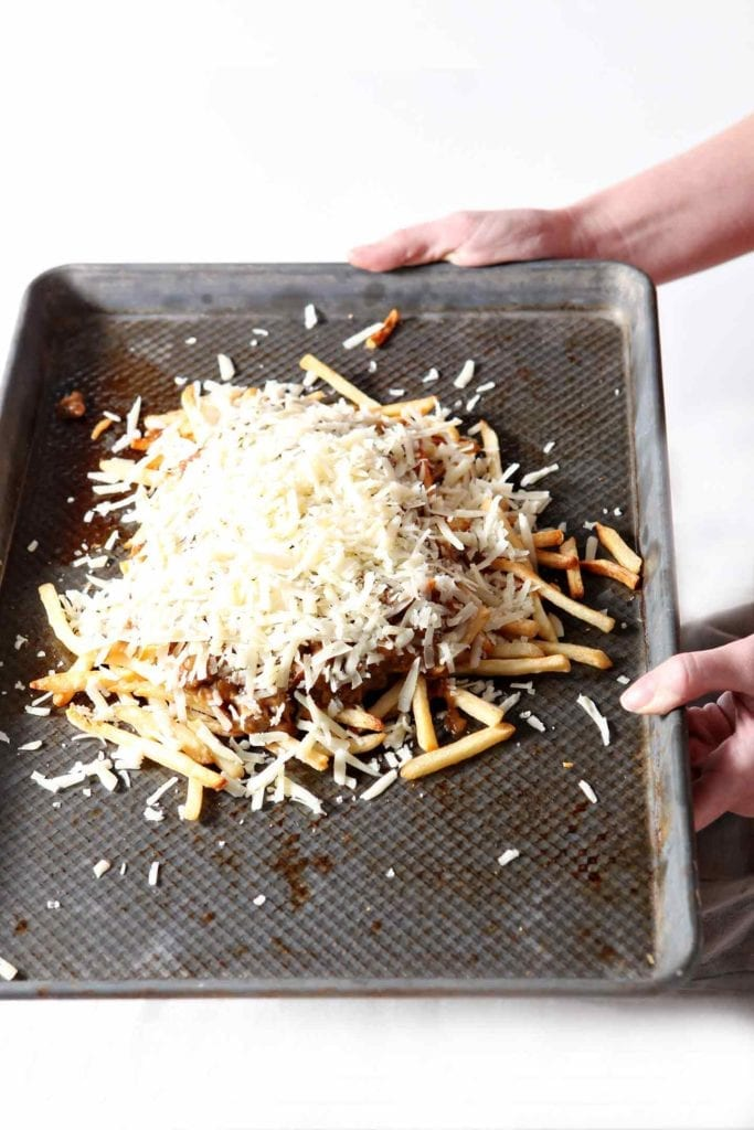 French Onion Poutine makes a delicious appetizer for your next gathering! This twist on the classic incorporates caramelized onions, beef, thyme and gruyere. | French Onion Poutine | Homemade Poutine | Onion Poutine | Gameday Appetizer | Party Appetizer | Easy Entertaining | Homemade Comfort Food | Appetizer Recipe | Decadent Appetizer | Finger Food