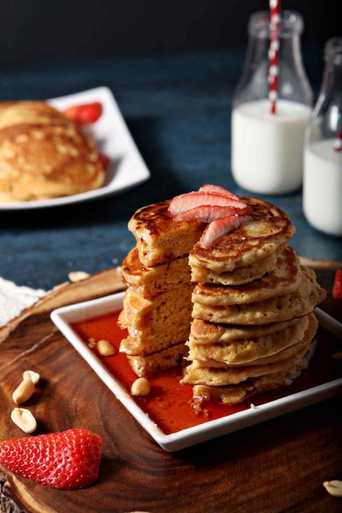a stack of pancakes with strawberries on top